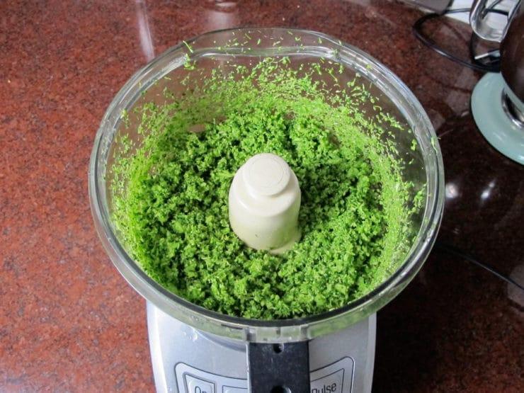 Broccoli chopped in a food processor.