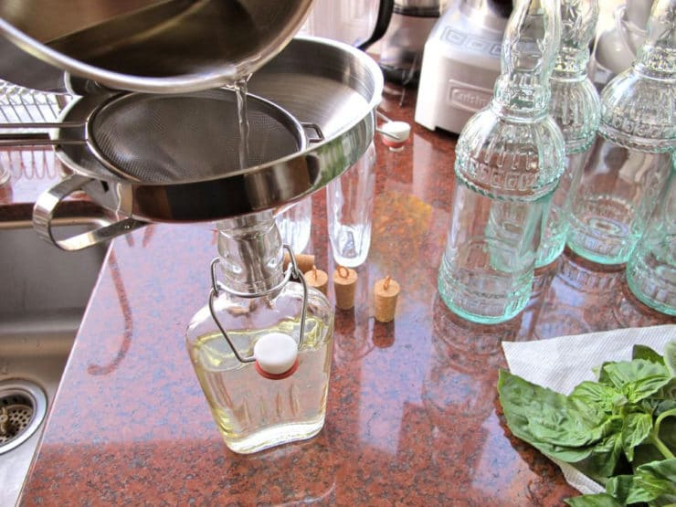 Straining simple syrup.