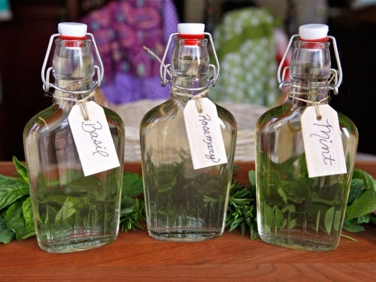 How to Make Herb Infused Simple Syrups - Tutorial for how to make herb infused simple syrups. Learn uses for herbal simple syrups and recipes for basil, mint, rosemary, thyme syrup and more.