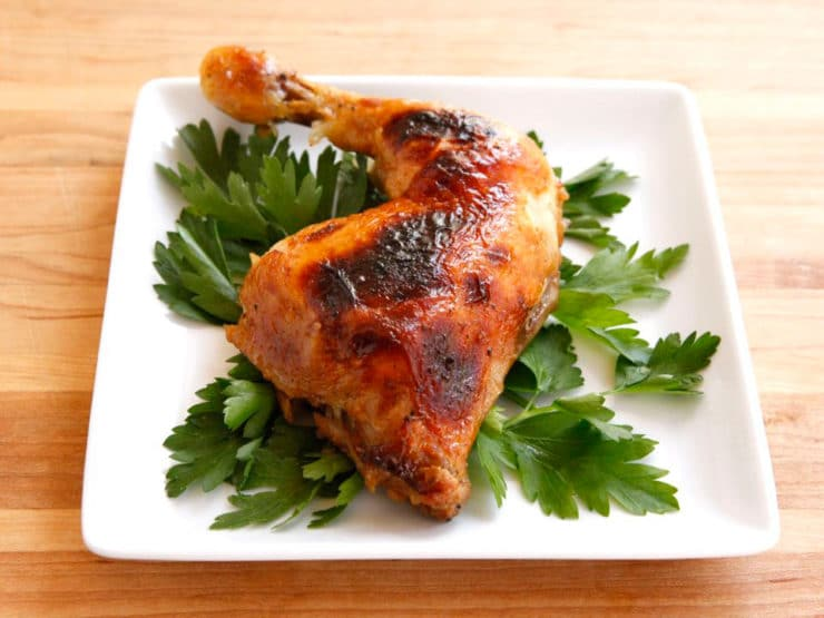 Honey Garlic Chicken - This simple, juicy roast chicken recipe yields moist flavorful meat and crispy golden skin with a sweet honey garlic sauce. Kosher for Passover.