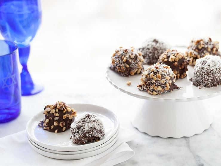 Kosher for Passover Chocolate Covered Marble Cake Bites - Kosher for Passover cake bites covered in dark chocolate and dipped in chopped nuts, sweetened coconut or any topping you'd like! From Heidi Larsen of FoodieCrush.