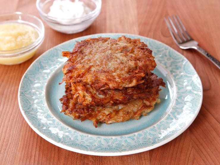 Passover Potato Latkes - Recipe for crispy fried potato and onion latkes made with matzo meal from Michelle Chiklis at Carpool, Couture and Cocktails. Kosher for Passover.