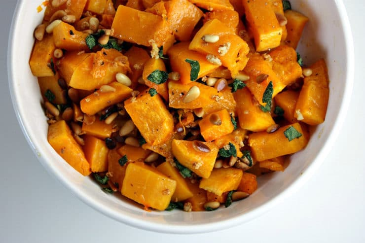Roasted Butternut Squash with Sage and Pine Nuts - Kosher for Passover roasted butternut squash tossed with sauteed garlic, sage and pine nuts. The perfect side dish for your Passover seder from Lori Lange of RecipeGirl.