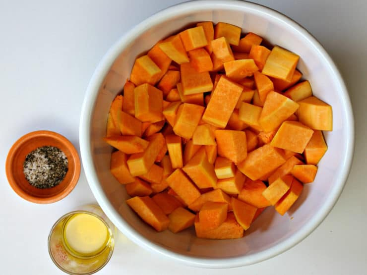 Diced butternut squash in a mixing bowl.