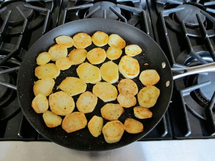 Frying potatoes in a skillet.