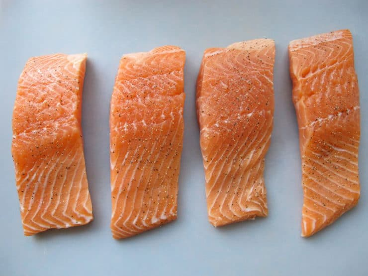 Salmon fillets on a cutting board.
