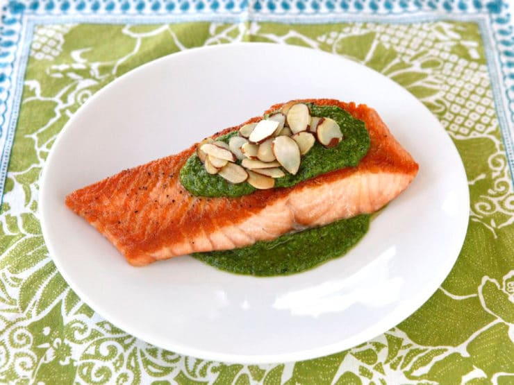 Seared Salmon with Toasted Almond Pesto - Seared salmon with a golden crust, topped with creamy dairy-free basil toasted almond pesto made with Meyer lemon juice. Kosher for Passover.