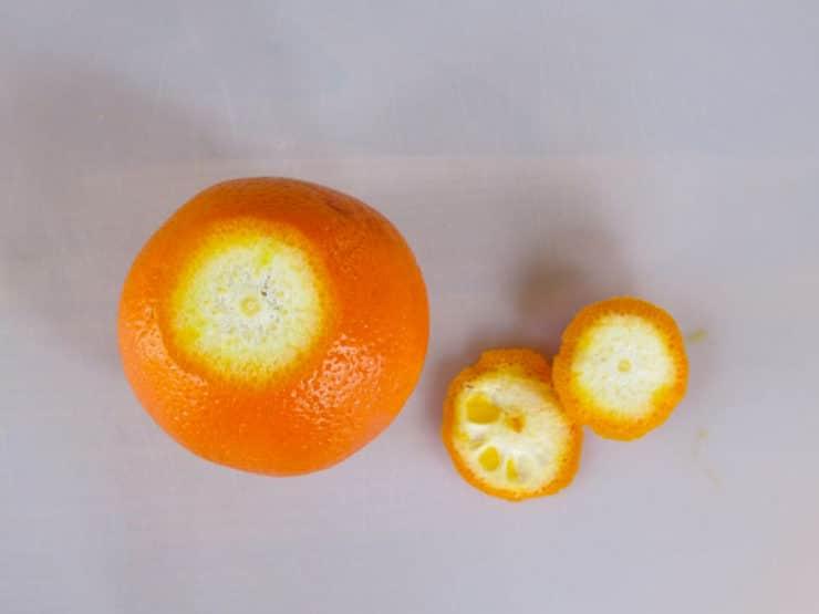 Peel ends sliced off an orange.