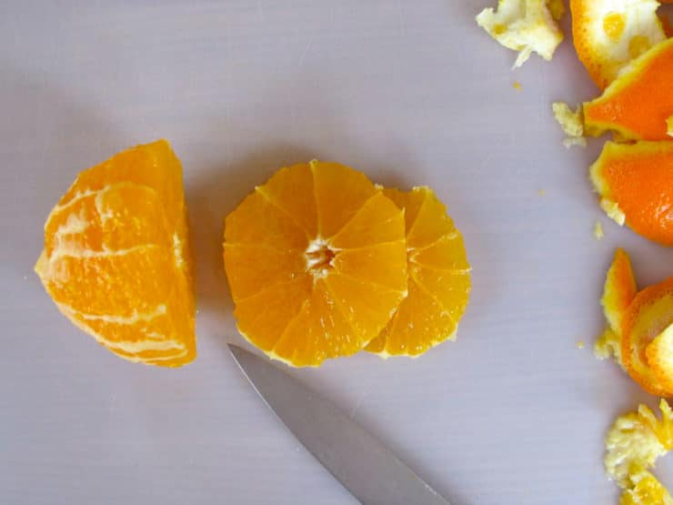 Slicing an orange into rounds.