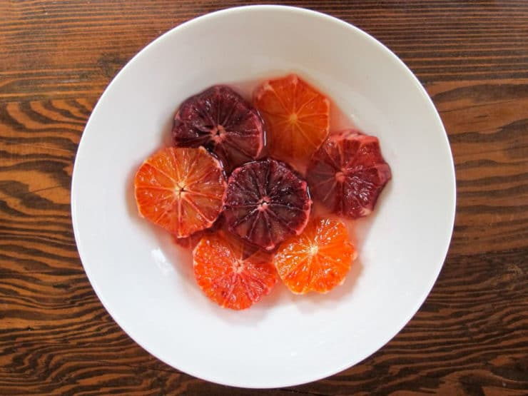 Sliced blood oranges in a bowl.