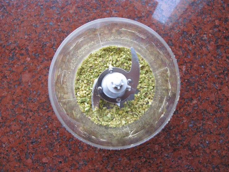 Chopping pistachios in a food processor.