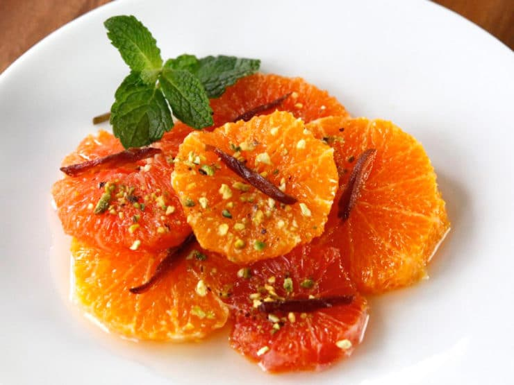 Sweet Citrus Rosemary Medley - A light dessert made from oranges, sweet rosemary syrup, pistachios and dates. Easy make-ahead dessert. Vegan, gluten free, Kosher for Passover