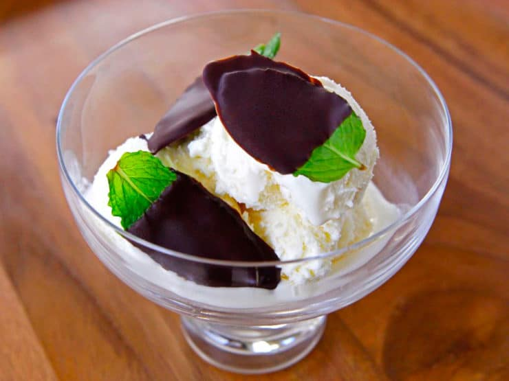 Escape with Ghiradelli Intense Dark: Dark Chocolate Mint Leaves - Natural bite-sized mint dessert. Large fresh mint leaves frozen in Ghirardelli Twilight Delight Intense Dark Chocolate.