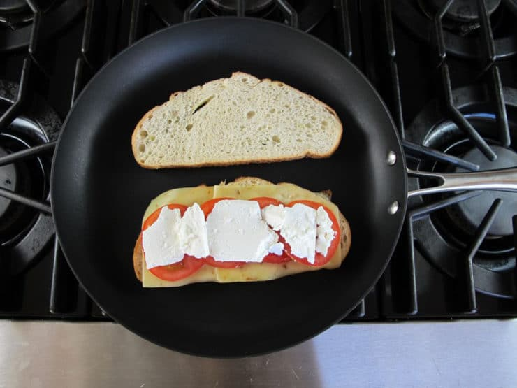 Feta cheese on top of sourdough in a skillet.