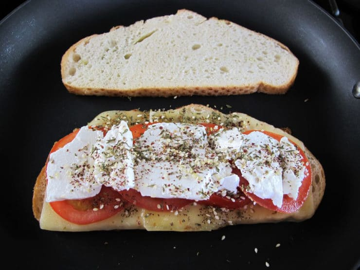 Spices sprinkled over feta cheese.