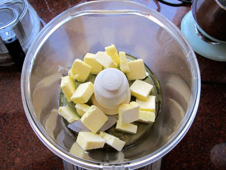 Sliced butter in the food processor.