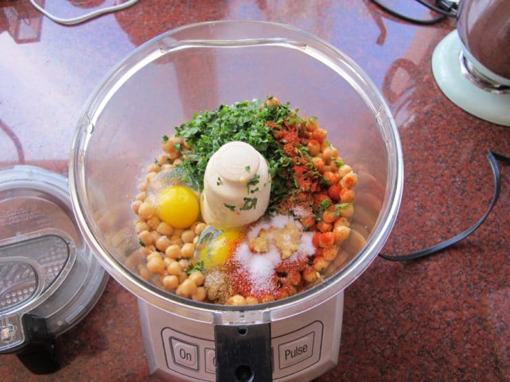 Chickpeas, eggs, seasonings in the food processor.
