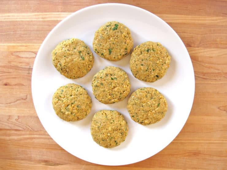 Formed chickpea patties on a plate.