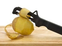 Knife to clean potatoes.  Isolated on white.