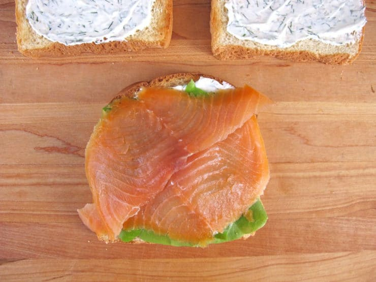 Lettuce and smoked salmon on a slice of toast.
