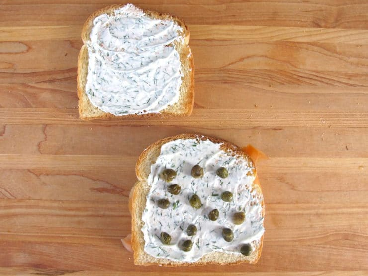 Capers on cream cheese on a slice of toast.