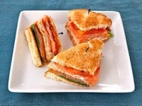 Smoked Salmon Club Sandwich - A simple and delicious club sandwich with smoked salmon, capers, cream cheese spread, lettuce and tomato. Kosher.