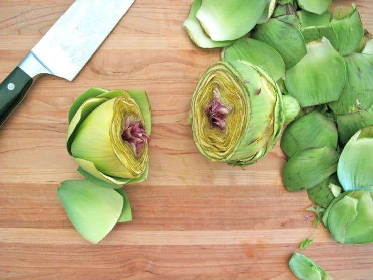 Artichoke sliced in half horizontally.