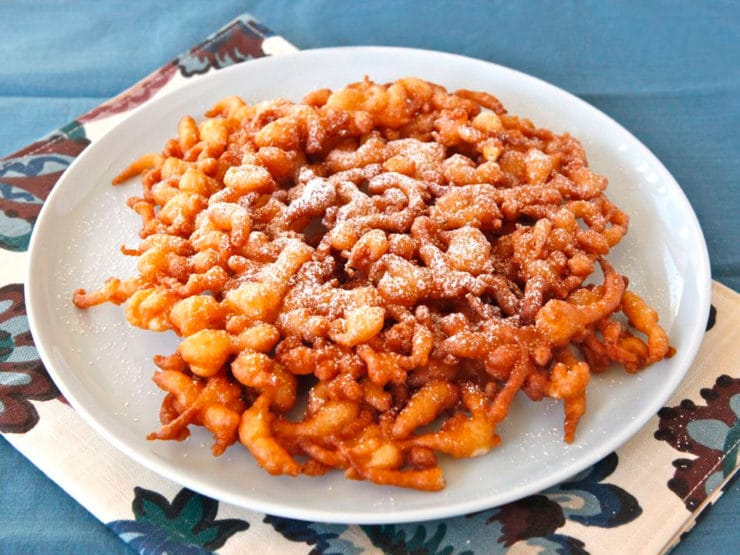 Funnel Cake - Learn the history of funnel cake, from medieval Anglo-Norman times to present, and try a tasty traditional Pennsylvania Dutch recipe from 1916.