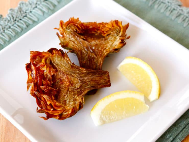 Jewish Fried Artichokes - Recipe and step-by-step photo tutorial for crispy and savory Jewish Fried Artichokes. Includes steps for cleaning and prepping artichokes.
