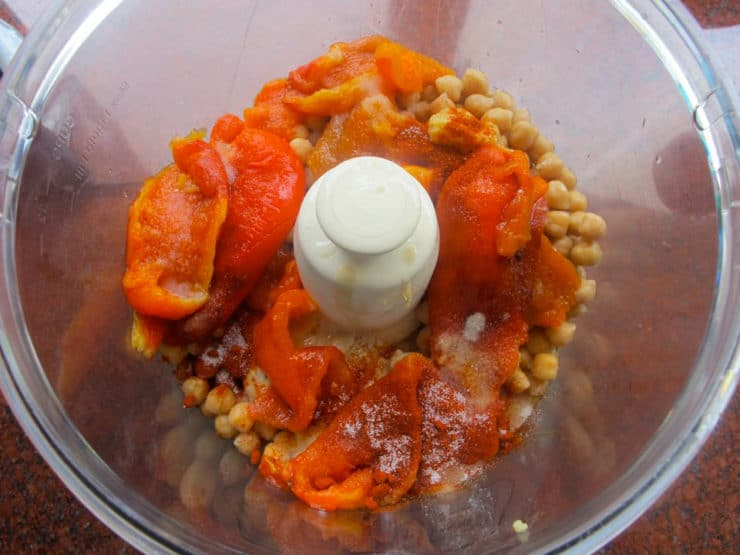 Roasted red peppers in a food processor.