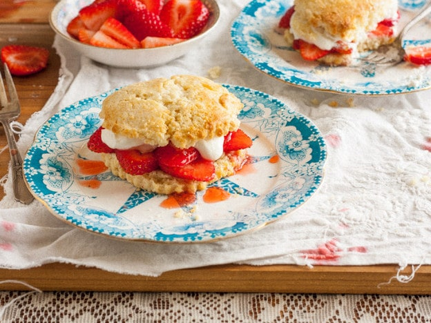 Strawberry shortcake on a blue and white plate.