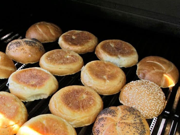 Toasting burger buns on the grill.