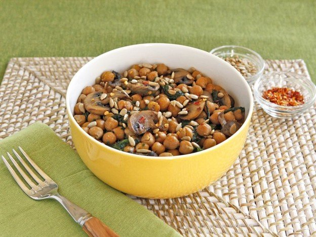 Chickpea, Spinach & Mushroom Sauté - A simple vegan meatless one-pot meal with seared mushrooms, chickpeas, spinach and seasonings, topped with sunflower seeds.