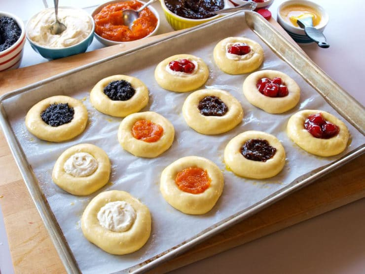 American aFilled kolache on a lined baking sheet.Cakes: Kolache - Learn the history of Czech kolaches, then try a traditional recipe with fillings and posipka from food historian Gil Marks