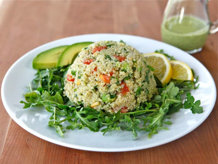 Quinoa Avocado Tabbouleh - In this modern take on tabbouleh salad, I've replaced bulgur with quinoa and added ripe avocado and pine nuts. Creamy dairy-free basil dressing. Healthy, gluten free recipe.