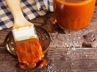 "Southern-Style Barbecue Sauce - Chef Louise Mellor shares a vintage 1965 recipe for Barbecue Sauce from ""The Southern Cookbook - 250 Fine Old Recipes."" Bright, tangy, spicy and slightly sweet."
