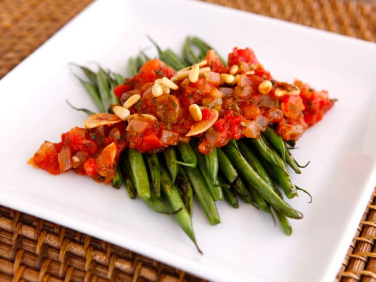 Caponata-Style Green Beans - Sautéed green beans topped with an Italian-inspired caponata sauce and toasted pine nuts. Tasty vegetarian side dish. Rosh Hashanah recipe.