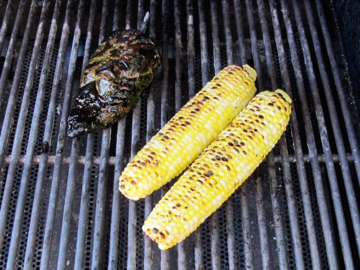 Corn cobs and poblano pepper on the grill.