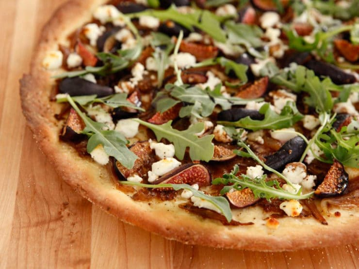 Fig and Goat Cheese Pizza - A recipe for fig and goat cheese pizza with homemade crust, caramelized onions, arugula and a balsamic reduction.