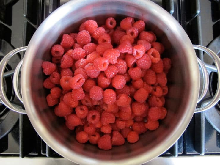 Fresh raspberries in a saucepan.
