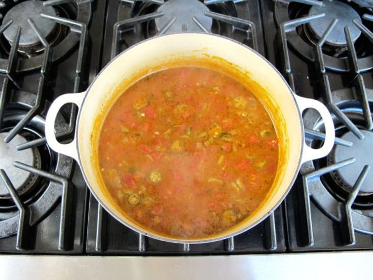 Okra soup simmering in a Dutch oven.