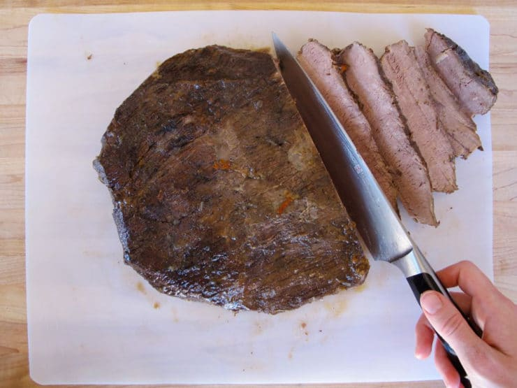 Slicing beef brisket.