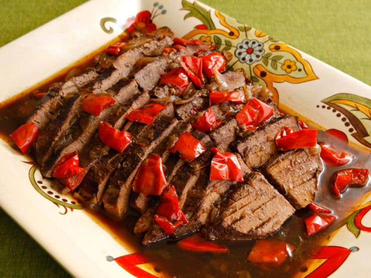 Rum and Coffee Brisket - Recipe for rum and coffee brisket cooked with onions, garlic and red bell peppers. Savory and perfect for the holidays. Kosher, Jewish.
