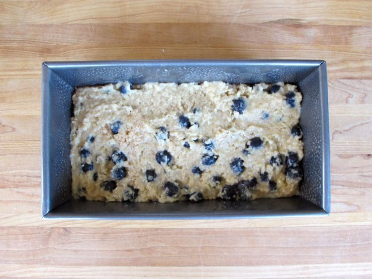 Blueberry cake batter in a loaf pan.