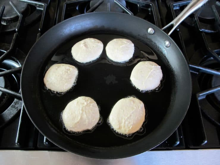 Griddle cakes in a skillet.