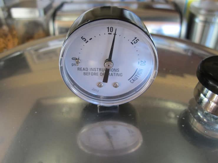 Pointer of gauge on pressure canner lid pointing at 11.