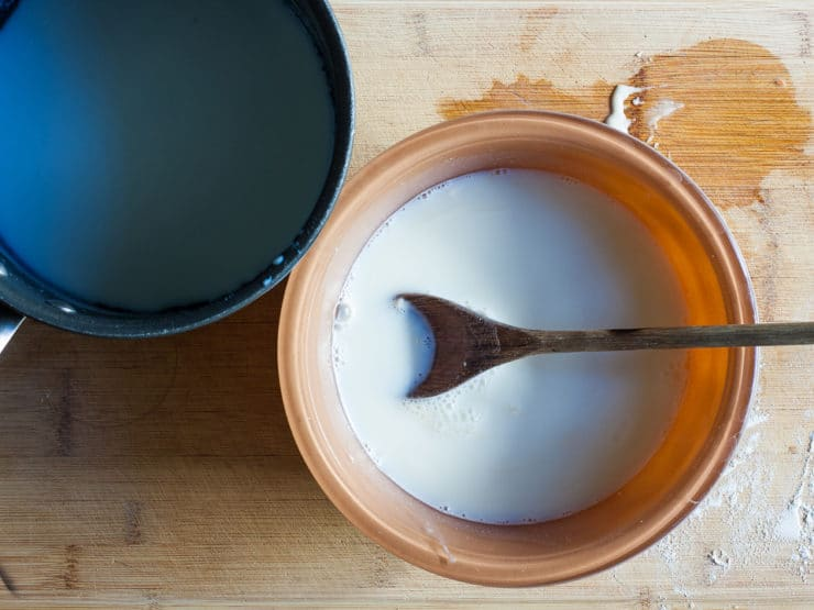 Steeping vanilla in milk and sugar.
