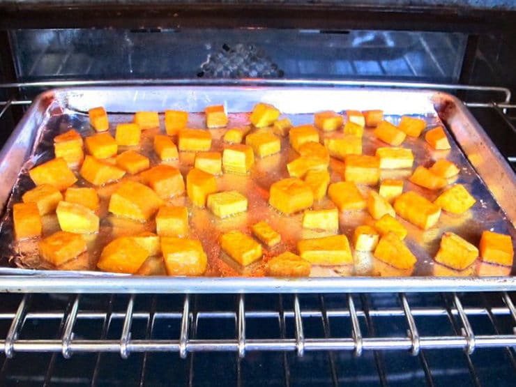Roasting cubed butternut squash in oven.