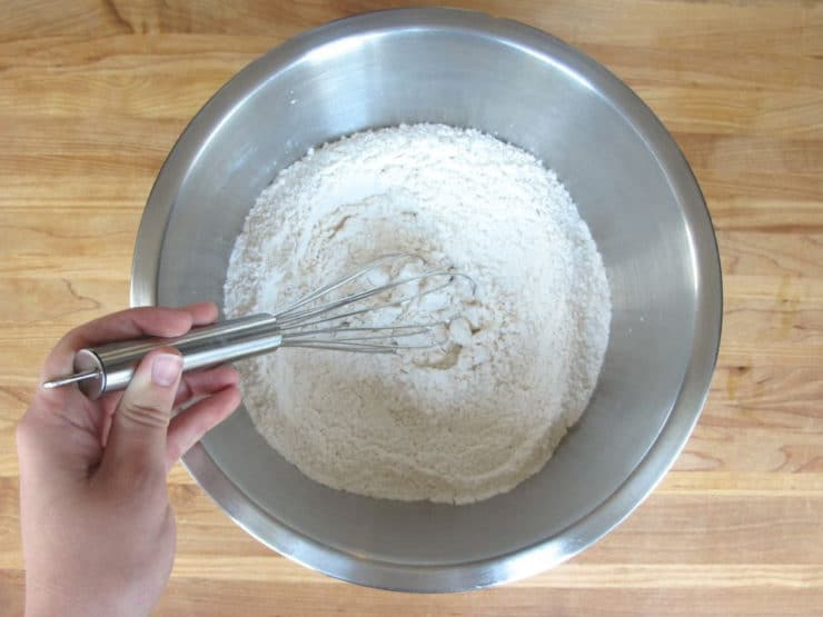 Whisk flour and dry ingredients in a mixing bowl.