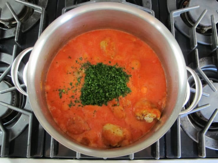 Parsley and seasonings added to paprikash pot.